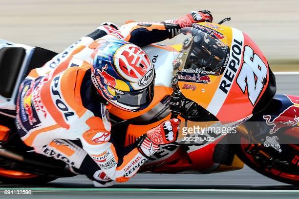 Repsol Honda Team's Spanish rider Dani Pedrosa rides during the second MotoGP free practice session of the Moto Grand Prix de Catalunya at the...