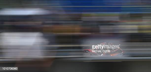 Repsol Honda Team's Spanish rider Dani Pedrosa rides his Honda during a free practice session of the Moto GP Grand Prix of the Czech Republic in Brno...