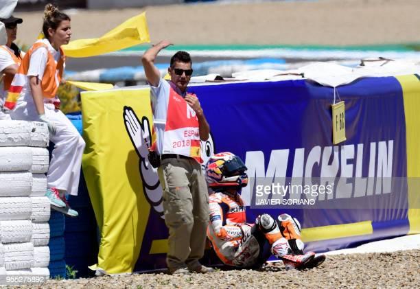 Repsol Honda Team's Spanish rider Dani Pedrosa sits after falling down during the MotoGP race of the Spanish Grand Prix at the Jerez Angel Nieto...