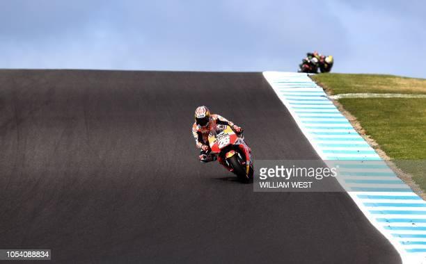 Repsol Honda Team's Spanish rider Dani Pedrosa speeds through a corner during qualifying at the Phillip Island circuit on October 27 ahead of the...