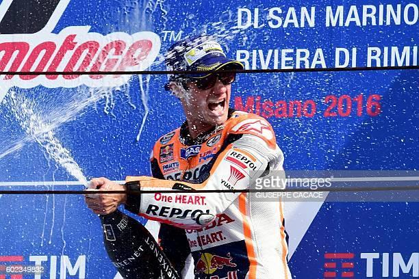 Repsol Honda Team's Spanish rider Dani Pedrosa sprays champagne as he celebrates on the podium after winning the San Marino Moto GP Grand Prix race...