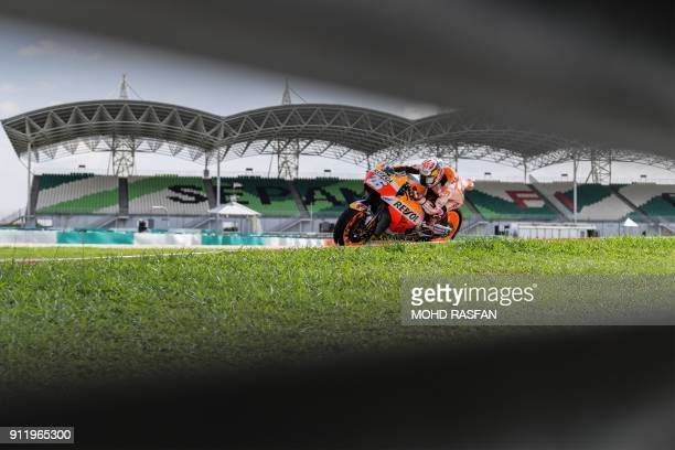 TOPSHOT Repsol Honda Team's Spanish rider Dani Pedrosa steers his bike after taking a corner during the last day of the 2018 MotoGP preseason test at...