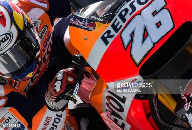 Repsol Honda Team's Spanish rider Dani Pedrosa takes a corner during the first day of the 2018 MotoGP preseason test at the Sepang International...