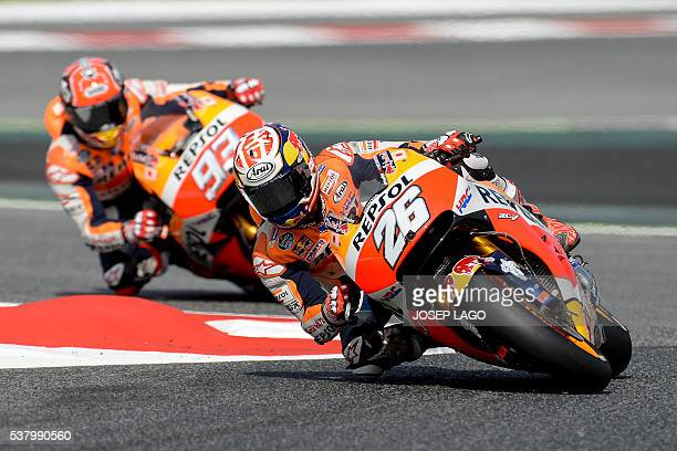 Repsol Honda Team's Spanish rider Daniel Pedrosa rides ahead his teammate Repsol Honda Team's Spanish rider Marc Marquez in the chicane included in...