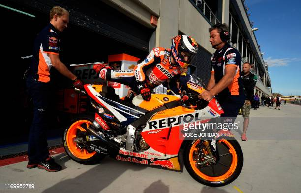 Repsol Honda Team's Spanish rider Jorge Lorenzo gets ready for the third MotoGP free practice session of the Moto Grand Prix of Aragon at the...