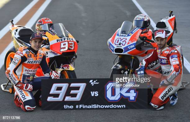 Repsol Honda Team's Spanish rider Marc Marquez and Ducati Team's Italian rider Andrea Dovizioso pose during a photocall in Valencia on November 9...