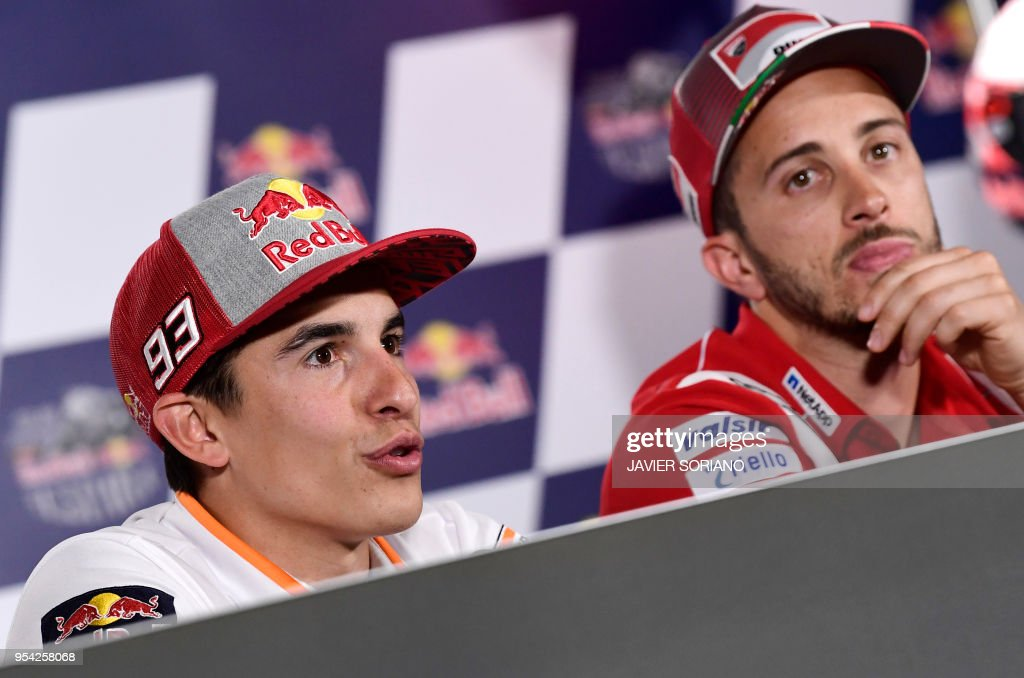 Repsol Honda Team's Spanish rider Marc Marquez (L) and Ducati Team's Italian rider Andrea Dovizioso attend a press conference during the Red Bull Grand Prix of Spain at Jerez de la Frontera race track on May 3, 2018.