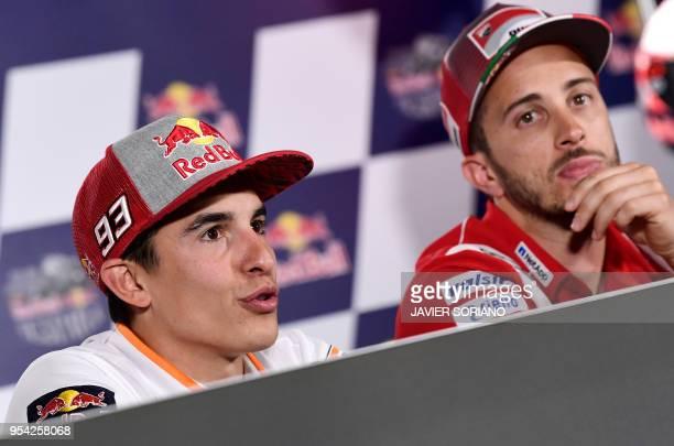 Repsol Honda Team's Spanish rider Marc Marquez and Ducati Team's Italian rider Andrea Dovizioso attend a press conference during the Red Bull Grand...