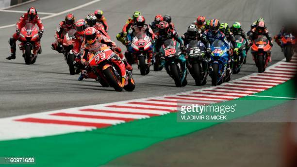 Repsol Honda Team's Spanish rider Marc Marquez and others ride their motorbikes during the race of the Austrian Moto GP Grand Prix in Spielberg on...