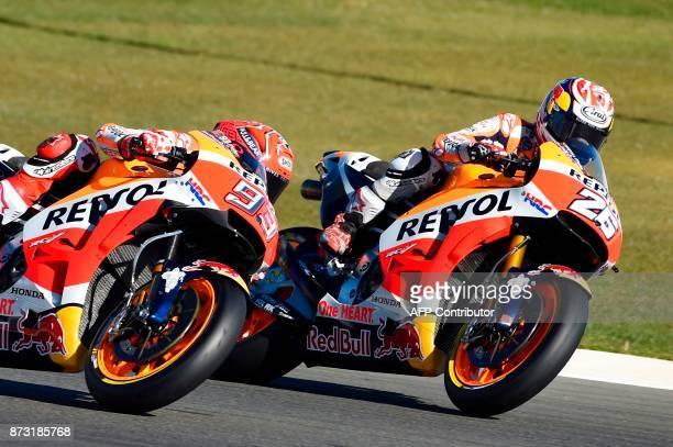 Repsol Honda Team's Spanish rider Marc Marquez and Repsol Honda Team's Spanish rider Dani Pedrosa ride during the MotoGP race of the Valencia Grand...