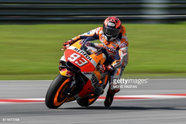 Repsol Honda Team's Spanish rider Marc Marquez brakes before taking a corner during the last day of the 2018 MotoGP preseason test at the Sepang...