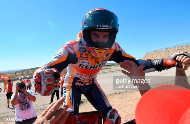Repsol Honda Team's Spanish rider Marc Marquez celebrates after winning the MotoGP race of the Moto Grand Prix of Aragon at the Motorland circuit in...