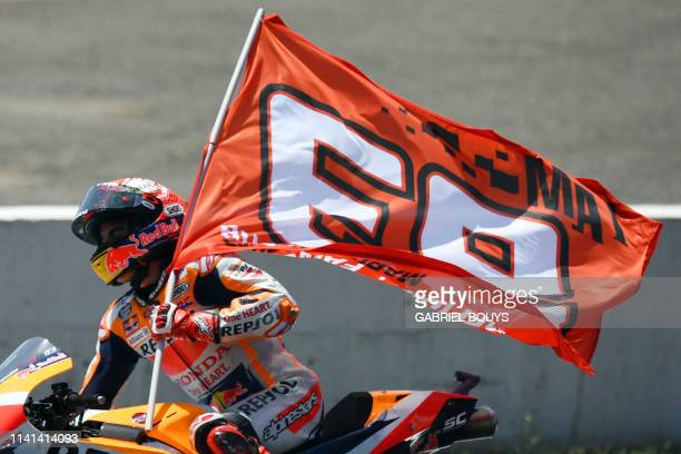 Repsol Honda Team's Spanish rider Marc Marquez celebrates after winning the MotoGP race of the Spanish Grand Prix at the Jerez Angel Nieto circuit in...
