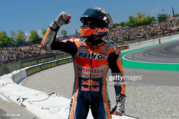 Repsol Honda Team's Spanish rider Marc Marquez celebrates after winning the Catalunya MotoGP Grand Prix race at the Catalunya racetrack in Montmelo,...