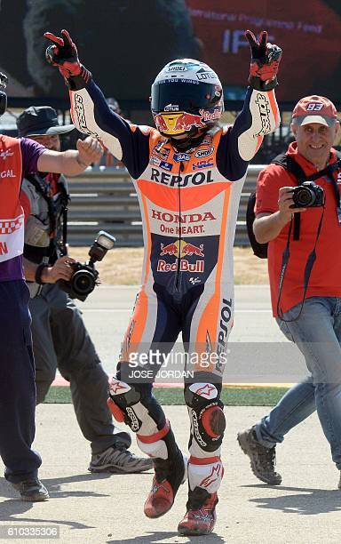 Repsol Honda Team's Spanish rider Marc Marquez celebrates after winning the Moto GP race of the Aragon Grand Prix at the Motorland racetrack in...