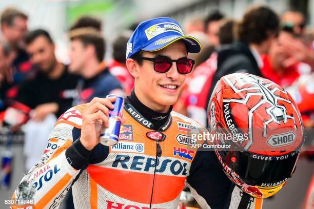 Repsol Honda Team's Spanish rider Marc Marquez celebrates after winning the qualifying session of the MotoGP Austrian Grand Prix weekend at Red Bull...