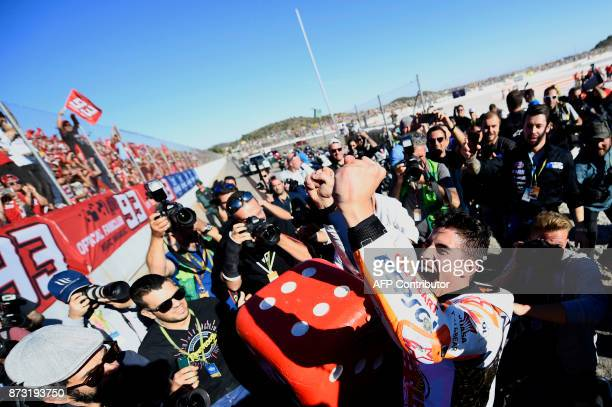 Repsol Honda Team's Spanish rider Marc Marquez celebrates after the MotoGP race of the Valencia Grand Prix at Ricardo Tormo racetrack in Cheste near...