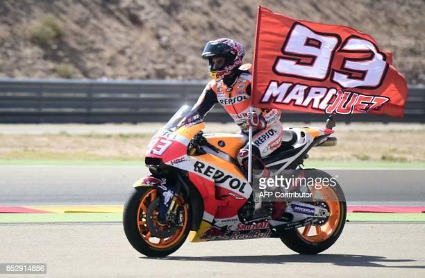 Repsol Honda Team's Spanish rider Marc Marquez celebrates on his bike winnig the MotoGP race of the Moto Grand Prix of Aragon at the Motorland...