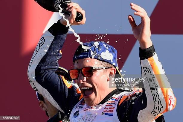 Repsol Honda Team's Spanish rider Marc Marquez celebrates on the podium of the MotoGP race of the Valencia Grand Prix at Ricardo Tormo racetrack in...