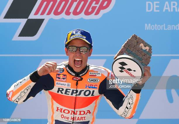 Repsol Honda Team's Spanish rider Marc Marquez celebrates on the podium after winning the MotoGP race of the Moto Grand Prix of Aragon at the...