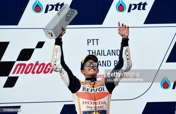 TOPSHOT Repsol Honda Team's Spanish rider Marc Marquez celebrates on the podium after winning the MotoGP race of the inaugural Thailand Grand Prix at...