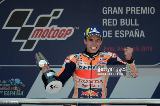 Repsol Honda Team's Spanish rider Marc Marquez celebrates on the podium after the MotoGP race of the Spanish Grand Prix at the Jerez - Angel Nieto...