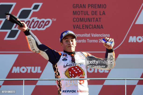 Repsol Honda Team's Spanish rider Marc Marquez celebrates on the podium after the MotoGP race of the Valencia Grand Prix at Ricardo Tormo racetrack...