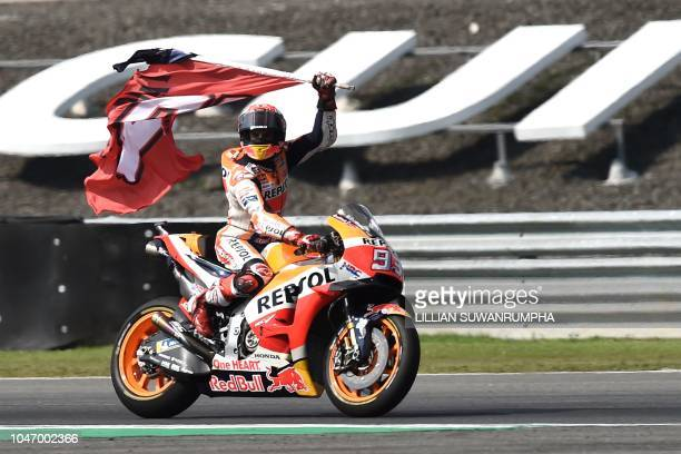TOPSHOT Repsol Honda Team's Spanish rider Marc Marquez celebrates on the track after winning the MotoGP race of the inaugural Thailand Grand Prix at...