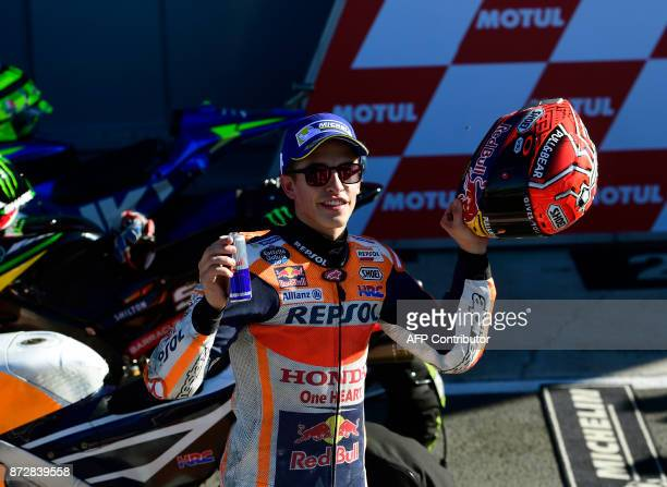 Repsol Honda Team's Spanish rider Marc Marquez celebrates taking the pole position after the second MotoGP qualifying session of the Valencia Grand...