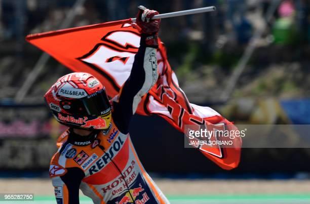 Repsol Honda Team's Spanish rider Marc Marquez celebrates winning the MotoGP race of the Spanish Grand Prix at the Jerez Angel Nieto racetrack in...