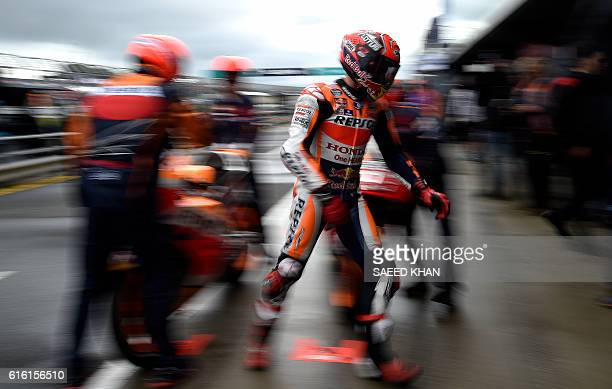 Repsol Honda Team's Spanish rider Marc Marquez changes his bike prior to the qualifying session of the MotoGP class at the Australian Grand Prix at...