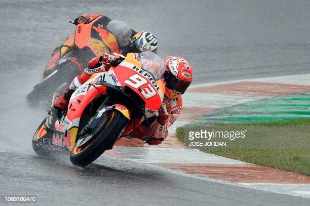 Repsol Honda Team's Spanish rider Marc Marquez competes during the MotoGP race of the Valencia Grand Prix at the Ricardo Tormo racetrack in Cheste on...