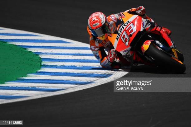 TOPSHOT Repsol Honda Team's Spanish rider Marc Marquez competes during the MotoGP race of the Spanish Grand Prix at the Jerez Angel Nieto circuit in...