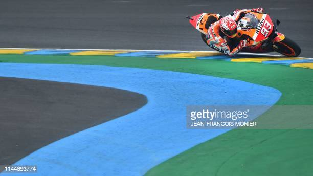 TOPSHOT Repsol Honda Team's Spanish rider Marc Marquez competes during the warmup MotoGP prior to the French Motorcycle Grand Prix in Le Mans...