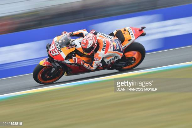 Repsol Honda Team's Spanish rider Marc Marquez competes during the warm-up MotoGP prior to the French Motorcycle Grand Prix, in Le Mans, northwestern...