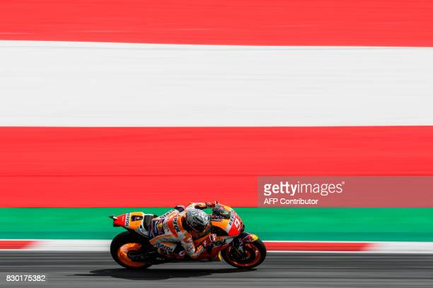 Repsol Honda Team's Spanish rider Marc Marquez competes during the second practice session of the MotoGP Austrian Grand Prix weekend at Red Bull Ring...