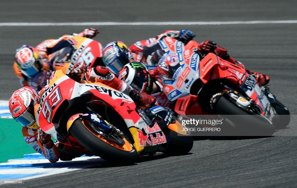 Repsol Honda Team's Spanish rider Marc Marquez (L) competes during the MotoGP race of the Spanish Grand Prix at the Jerez Angel Nieto racetrack in Jerez de la Frontera on May 6, 2018.