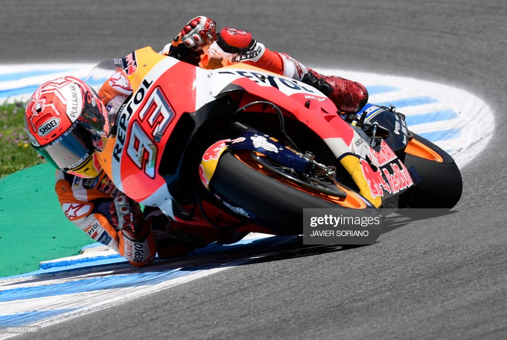 Repsol Honda Team's Spanish rider Marc Marquez competes during the MotoGP race of the Spanish Grand Prix at the Jerez Angel Nieto racetrack in Jerez de la Frontera on May 6, 2018.