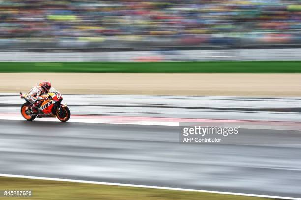 TOPSHOT Repsol Honda Team's Spanish rider Marc Marquez competes during the San Marino Moto GP Grand Prix at the Marco Simoncelli Circuit in Misano on...