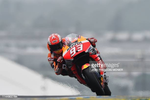 TOPSHOT Repsol Honda Team's Spanish rider Marc Marquez competes in the lead during the MotoGP race during the French Motorcycle Grand Prix in Le Mans...