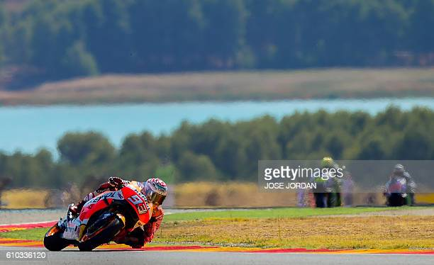 Repsol Honda Team's Spanish rider Marc Marquez competes to win the Moto GP race of the Aragon Grand Prix at the Motorland racetrack in Alcaniz on...