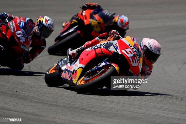 Repsol Honda Team's Spanish rider Marc Marquez competes with Ducati's Italian rider Andrea Dovizioso and Red Bull KTM Factory Racing's Spanish rider...