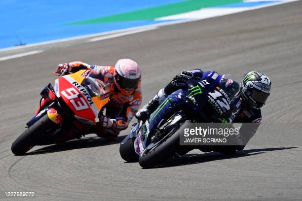Repsol Honda Team's Spanish rider Marc Marquez competes with Monster Energy Yamaha' Spanish rider Maverick Vinales during the MotoGP race of the...