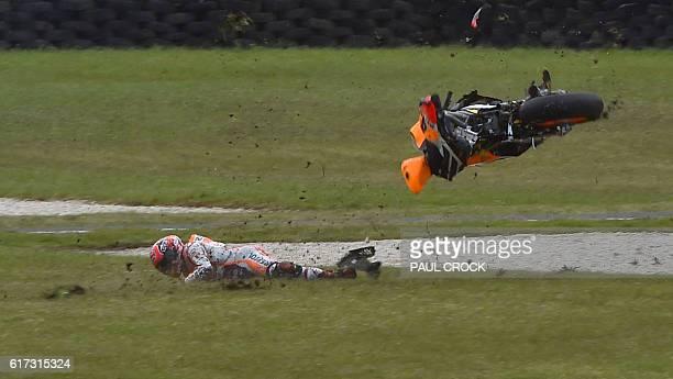 TOPSHOT Repsol Honda Team's Spanish rider Marc Marquez crashes during the MotoGP race at the Australian Grand Prix at Phillip Island on October 23...