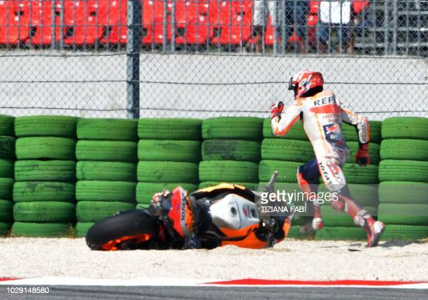 TOPSHOT Repsol Honda Team's Spanish rider Marc Marquez falls during the qualifying session of the San Marino MotoGP Grand Prix race at the Marco...