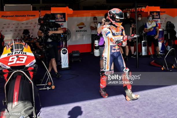 Repsol Honda Team's Spanish rider Marc Marquez gets ready to take part in the third MotoGP free practice session of the Andalucia Grand Prix at the...