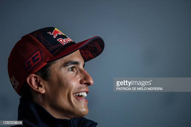 Repsol Honda Team's Spanish rider Marc Marquez gives a press conference at the Algarve International Circuit in Portimao on April 15 ahead of the...