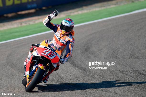 Repsol Honda Team's Spanish rider Marc Marquez greets from his bike after the Moto GP third free pratice of the Moto Grand Prix of Aragon at the...