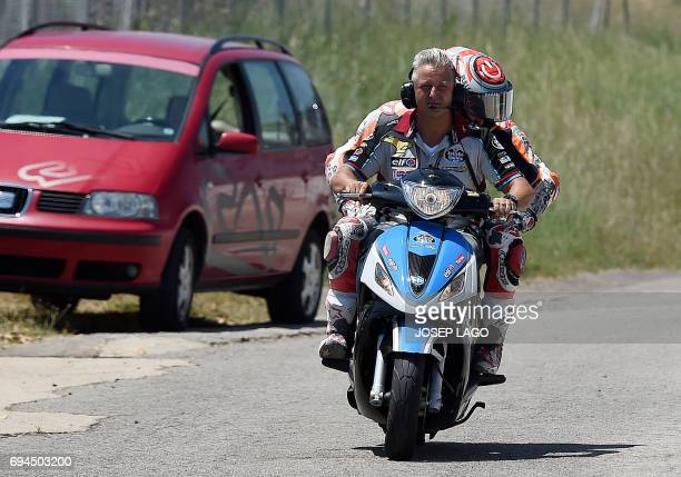 Repsol Honda Team's Spanish rider Marc Marquez is carried on a motorbike after crashing during the fourth MotoGP free practice session of the Moto...