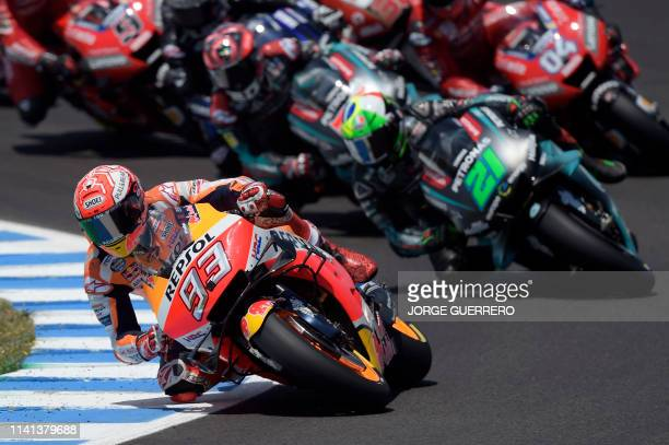 Repsol Honda Team's Spanish rider Marc Marquez leads the race after the start of the MotoGP race of the Spanish Grand Prix at the Jerez - Angel Nieto...